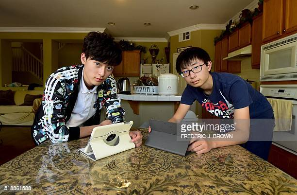 Chinese students Tony Lu from Anhui and Henry Li from Wuhan spend their free time connected to China on their internet devices at their host family's...