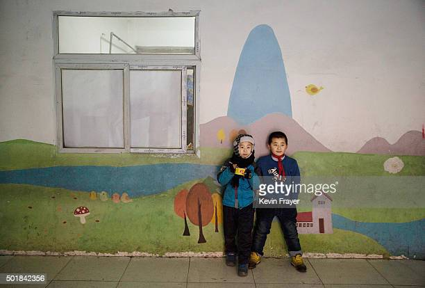 Chinese students who are children of migrants take a break at an unofficial school on December 18 2015 in Beijing China Schools for children of...