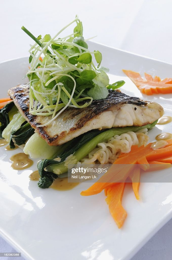 Chinese style fish with noodles and vegetables : Stock Photo