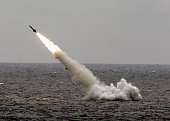 A Chinese submarine launches a missile in an offshore blockade exercise during the third phase of the SinoRussian 'Peace Mission 2005' joint military...