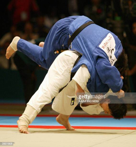 Chinese Sun Fuming throws Japanese Maki Tsukada during the final match of the women's over 87 kg category at the World Judo Championships in Osaka 11...