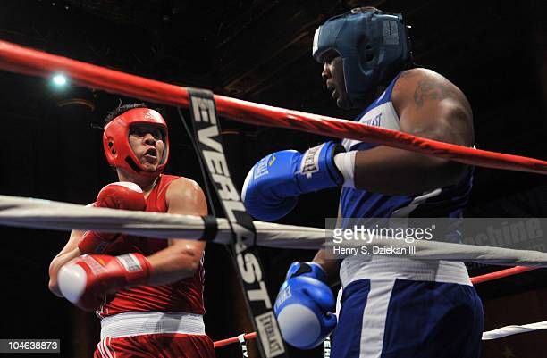 Chinese Super Heavyweight Boxer Zhang Zhilei and American Super Heavyweight Boxer Danny Kelly compete at Empires Collide China vs USA amateur boxing...