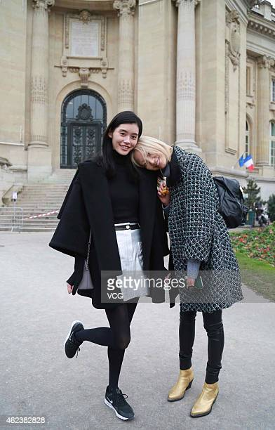 Chinese supermodel Ming Xi and Xi Mengyao seen during Paris Fashion Week Haute Couture Spring/Summer 2015 on January 27 2015 in Paris France