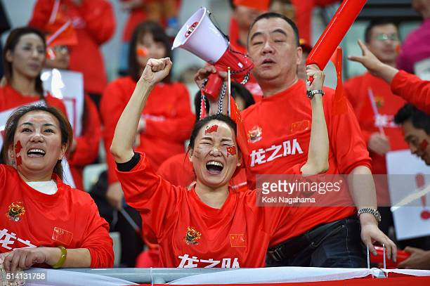 Chinese supporters celebrate their team's 10 win in the AFC Women's Olympic Final Qualification Round match between China and South Korea at Yanmar...
