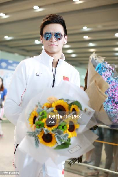 Chinese swimmer Sun Yang returns from Budapest 2017 FINA World Championships and arrives at Beijing Capital International Airport on August 1 2017 in...