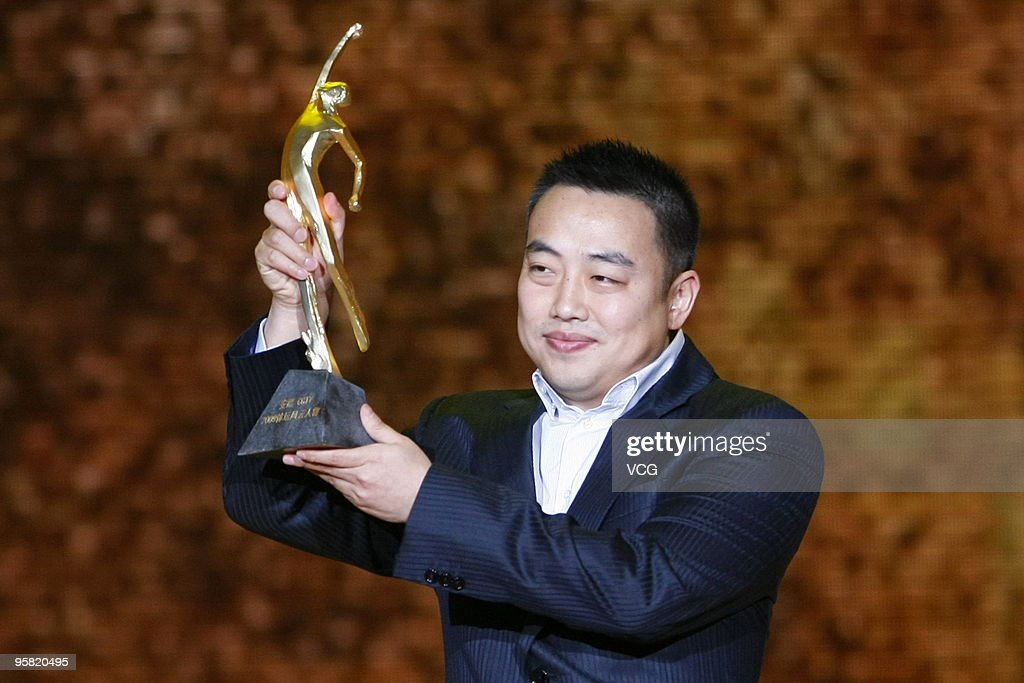 Chinese table tennis player <a gi-track='captionPersonalityLinkClicked' href=/galleries/search?phrase=Liu+Guoliang&family=editorial&specificpeople=655363 ng-click='$event.stopPropagation()'>Liu Guoliang</a> poses with the trophy during the CCTV Sports Personality Of The Year 2009 at Peking University Hall on January 16, 2010 in Beijing, China.
