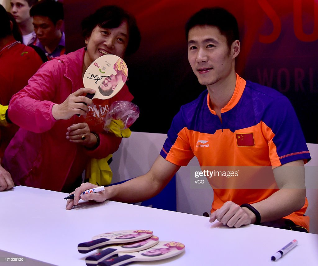 Chinese table tennis player <a gi-track='captionPersonalityLinkClicked' href=/galleries/search?phrase=Wang+Liqin&family=editorial&specificpeople=221536 ng-click='$event.stopPropagation()'>Wang Liqin</a> attends Double Happiness activity on day two of the 2015 World Table Tennis Championships on April 27, 2015 in Suzhou, China.