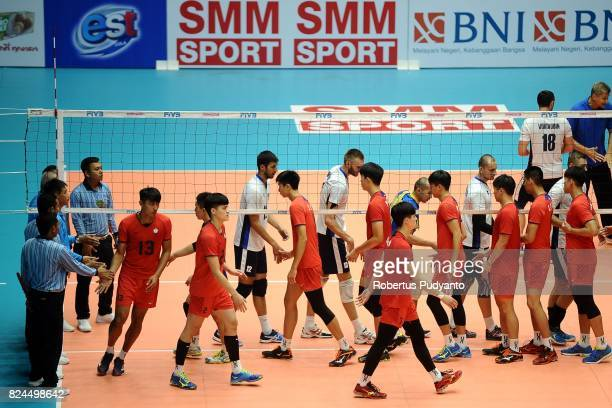 Chinese Taipei and Kazakhstan team shake hand during the 19th Asian Senior Men's Volleyball Championship quarterfinal match between Chinese Taipei...