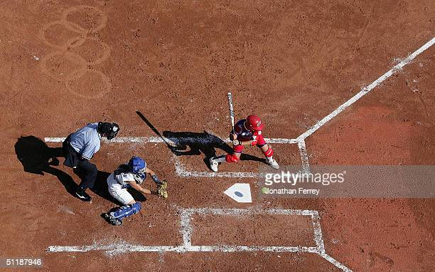 Chinese Taipei player takes a pitch over the plate against Italy during the preliminary softball game against Italy on August 18 2004 during the...