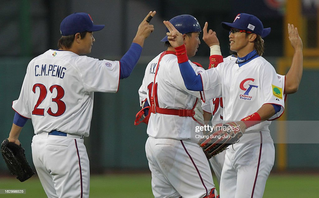 Chinese Taipei players celebrate after the winning against Netherlands during the World Baseball Classic First Round Group B match between the Netherland and Chinese Taipei at Intercontinental Baseball Stadium on March 3, 2013 in Taichung, Taiwan.