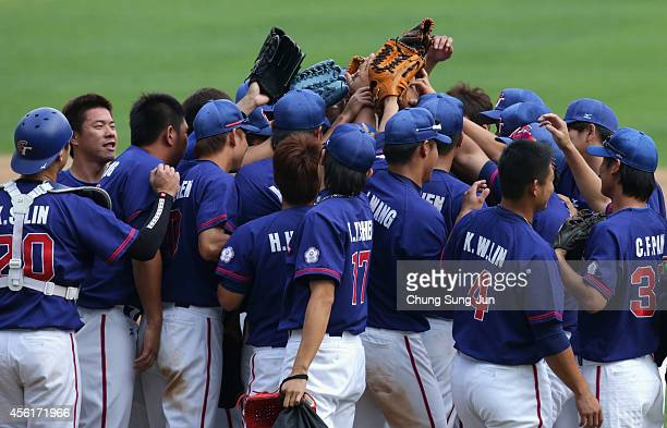 Chinese Taipei players celebrate their 104 win after the Baseball Semifinal match between Japan and Chinese Taipei during day eight of the 2014 Asian...