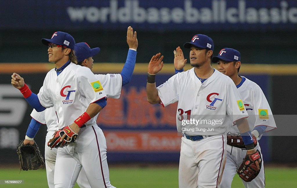 Chinese Taipei team player celebrate after the winning against Netherlands during the World Baseball Classic First Round Group B match between the Netherland and Chinese Taipei at Intercontinental Baseball Stadium on March 3, 2013 in Taichung, Taiwan.