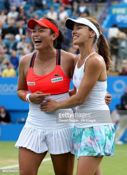 Chinese Taipei's Yungjan Chan and Switzerland's Martina Hingis celebrate winning against Australia's Ashley Barty and Casey Dellacqua in the Women's...