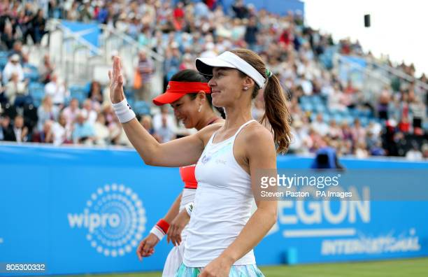 Chinese Taipei's Yungjan Chan and Switzerland's Martina Hingis celebrate winning against Australia's Ashleigh Barty and Casey Dellacqua in the...