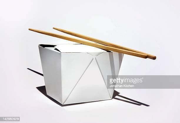 Chinese takeaway box with chopsticks