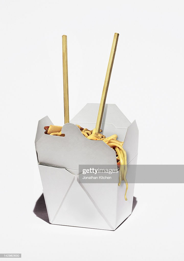 Chinese takeaway box with noodles and chopsticks