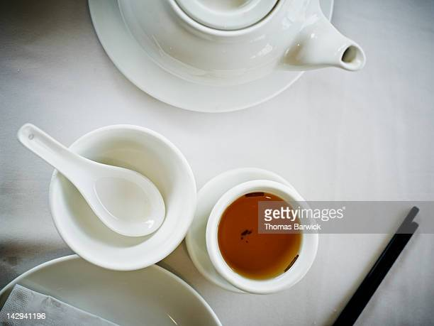 Chinese tea on table next to empty soup cup