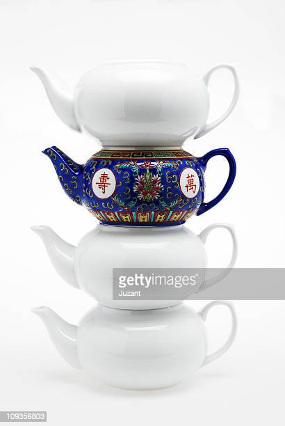 Chinese tea pots balanced one different