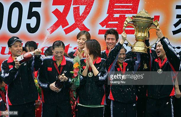 Chinese team celebrate during the victory ceremony to win the 2005 Sudirman Cup World Mixed Team Badminton Championships at the Capital Gymnasium on...