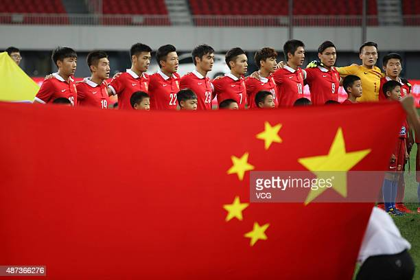 Chinese team gathers in front of a Chinese national flag during a match between China and Japan of 2015 'Changan Ford Cup' CFA International Youth...