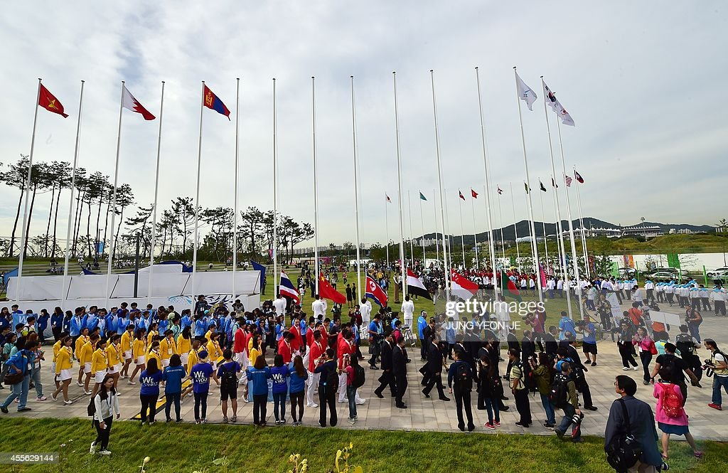Chinese team members attend a team welcoming ceremony at the athletes village of the 2014 Asian Games in Incheon on September 18 2014 AFP PHOTO /...