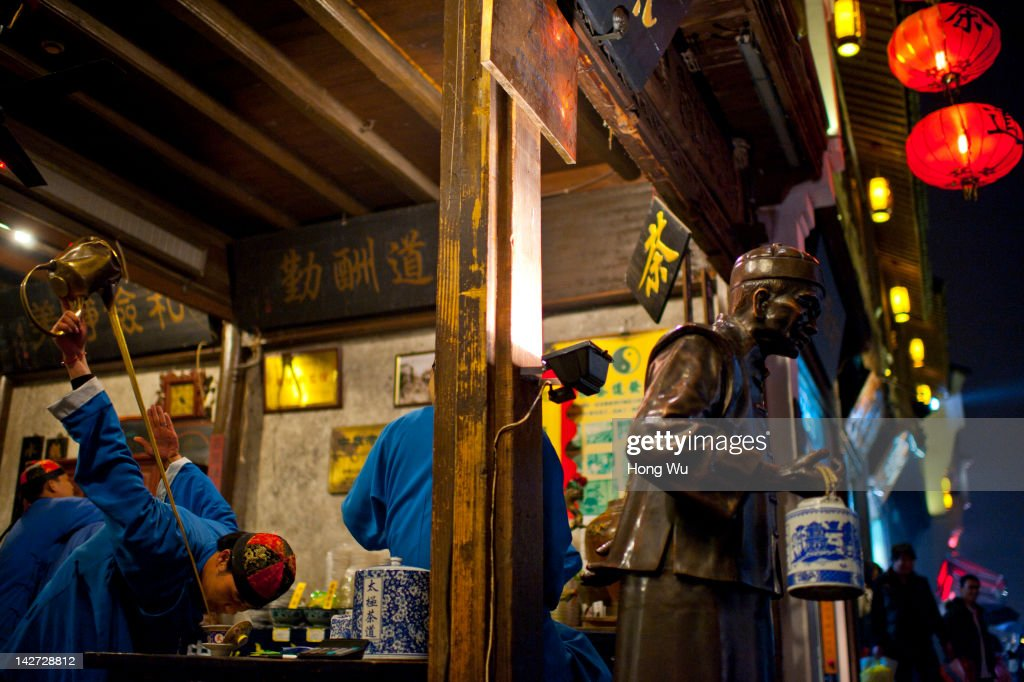 A Chinese tea-server dressed in traditional clothes performs his tea ceremony skill at TaiJi teahouse on March 30, 2012 in Hangzhou, China. Longjing is a green-tea, often called Dragon Well tea. The tea is typically picked by hand, and is of a high quality, earning the title of China Famous Tea. The Longjing tea begins to pluck before Chinese traditional Qingming Festival, the 15th day from the Spring Equinox or usually occurring around April 5. Many Chinese migrant workers from Jiangsu, Anhui, Jiangxi and other neighboring provices have been employed with 80 RMB yuan(US$12.68) to 120 RMB yuan(US$ 19.03) per day to pluck fresh Longjing tea leaves for villagers in many Longjing tea production villages in the outskirts of Hangzhou. The price of Longjing tea rose in recent years which aims to become to luxury goods. A high-end Longjing tea in Hangzhou sold for 50,000 RMB yuan(US$ 7930) half a kilo in 2012, the price rose 70 times in the last 12 years.