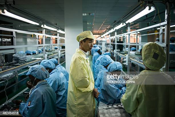 MBON Chinese technicians provide training and quality control at the VMK factory in Brazzaville on July 20 2015 The factory run by Verone Mankou...