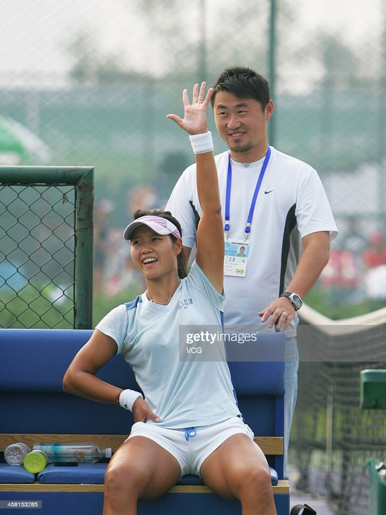 Chinese tennis player Li Na and her husband <a gi-track='captionPersonalityLinkClicked' href=/galleries/search?phrase=Jiang+Shan&family=editorial&specificpeople=6726616 ng-click='$event.stopPropagation()'>Jiang Shan</a> attend a practice session during the China Open 2006 on September 16, 2006 in Beijing, China.