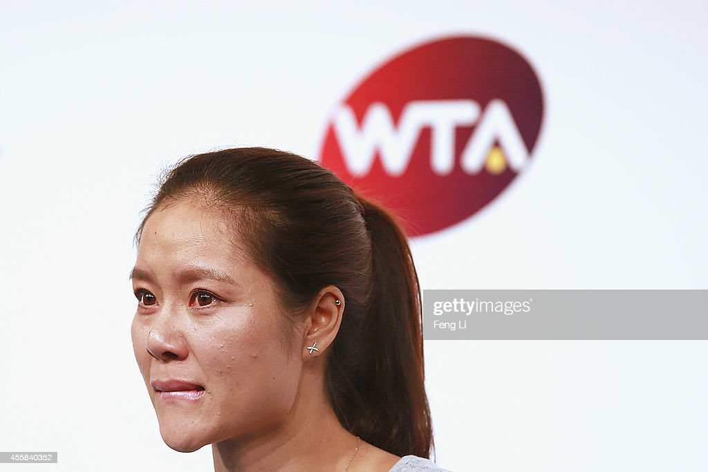 Chinese tennis player Li Na cries during her retirement press conference at the National Tennis Centre on September 21, 2014 in Beijing, China. The 32-year old two-time Grand Slam winner Li Na announces her retirement just on the day when Wuhan Open debuts in her hometown.