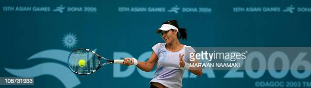 Chinese Tennis player Li Na practices on the central court of Shiekh Khalifa Tennis compound 30 November 2006 one day before the start of the 15th...