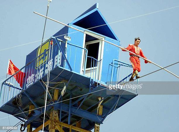Chinese tightrope walker Adili Wushouer a Uighur from China's western Xinjiang province begins his feat to remain on the tightrope for 22 days...