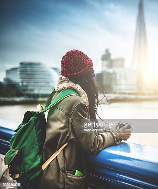 chinese tourist in london observing the skyline