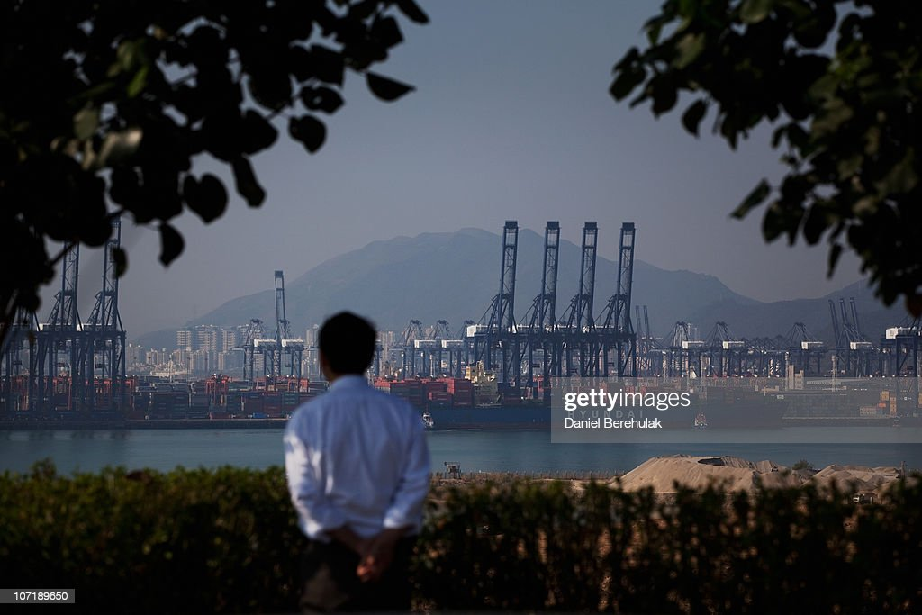A Chinese tourist looks out over Shenzhen Port on November 28, 2010 in Shenzhen, China. According to the US Commercial Service, Shenzhen is one of the fastest growing cities in the world. Home of the Shenzhen Stock Exchange and the headquarters of numerous technology companies, the now bustling former fishing village is considered southern China's major financial centre.