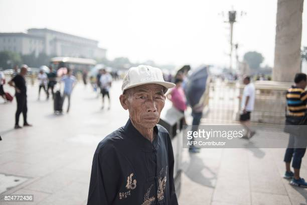 A Chinese tourist visits Tiananmen Square in Beijing on July 31 on the eve of the 90th founding anniversary of the People's Liberation Army The PLA...