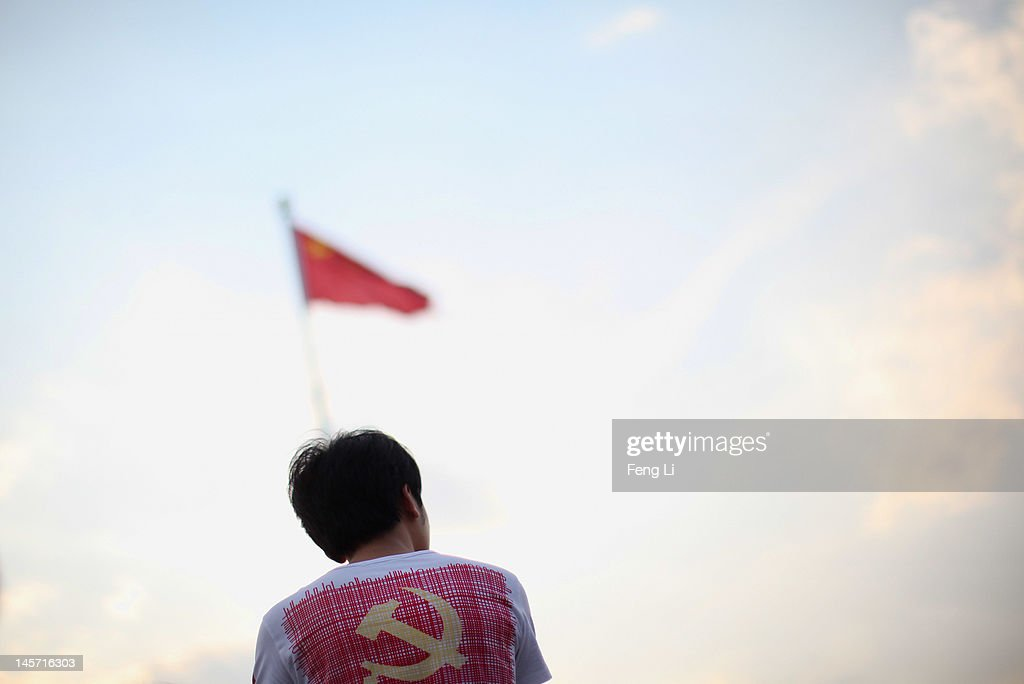 A Chinese tourist waits for watching the customary ceremony of lowering flag at Tiananmen Square on June 4, 2012 in Beijing, China.