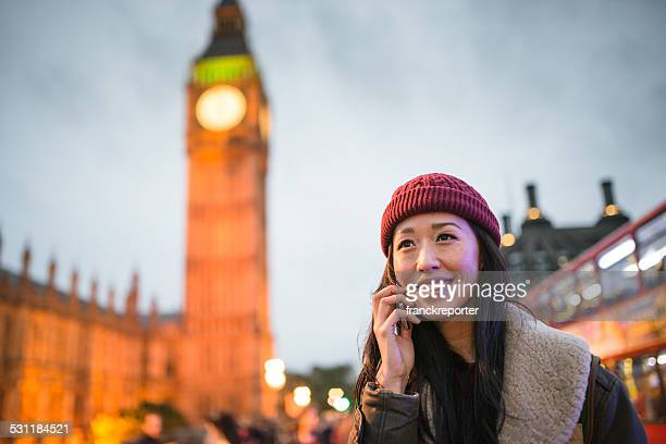 chinese tourist woman on the phone in london