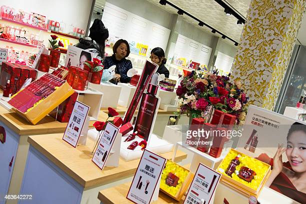 Chinese tourists browse cosmetics at an Amorepacific Corp Mamonde store in the Myeongdong shopping district in Seoul South Korea on Monday Feb 16...
