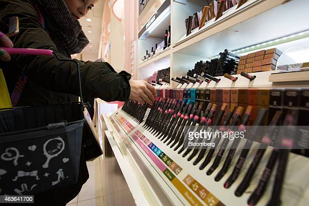 Chinese tourists browse shadow and eye liner at an Amorepacific Corp Etude House store in the Myeongdong shopping district in Seoul South Korea on...