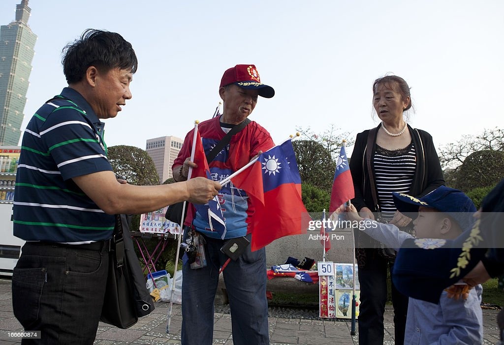 Chinese tourists buying Taiwan flags from a vendor in Dr. Sun Yet-sen Memorial Hall on April 15, 2013 in Taipei, Taiwan.