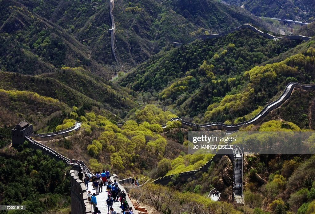 Chinese tourists climb the Great Wall at Badaling north of Beijing on April 22 2015 AFP PHOTO / JOHANNES EISELE