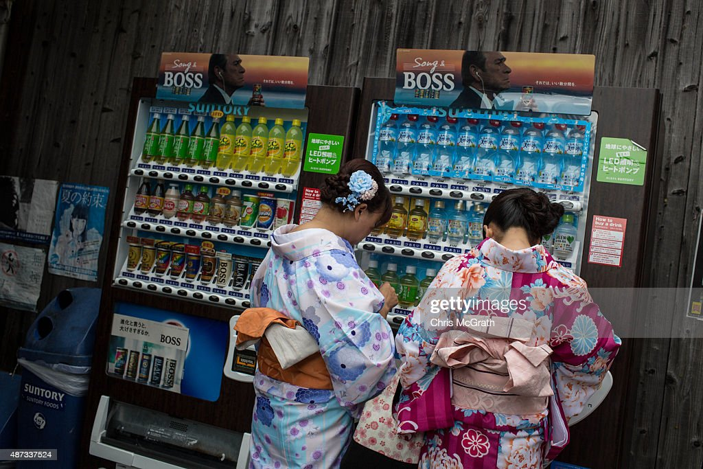 Chinese tourists dressed in traditional Japanese outfits use a vending machine at the entrance to the Kiyomizu Temple on September 7, 2015 in Kyoto, Japan. The famous city of Kyoto is going through a massive tourism boom. It recently won the title of World's Best City 2015, for the second consecutive year, in the consumer travel magazine Travel+Leisure, World's Best Awards. The total number of visitors to the city continues to climb year on year and the city has set a goal of achieving 3 million foreign tourists, equating to a tourist spend of 1 trillion yen (approx. $12 billion USD) by the time the Olympics arrive in 2020. However, such a surge in tourist numbers does not come without problems and recently, Kyoto city released two etiquette manuals to help tourists behave respectfully. The manuals, one for ' How to use a toilet' and the Akimahen (Don'ts of Kyoto) use cartoons and emoji's to explain 18 rules of correct tourist behavior, some of which include, where to smoke, when to take your shoes off, where and when you are able to take photographs and how to act appropriately at temples and shrines.