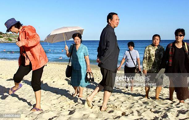 Chinese tourists enjoy the sands of Bondi Beach05 September 2002