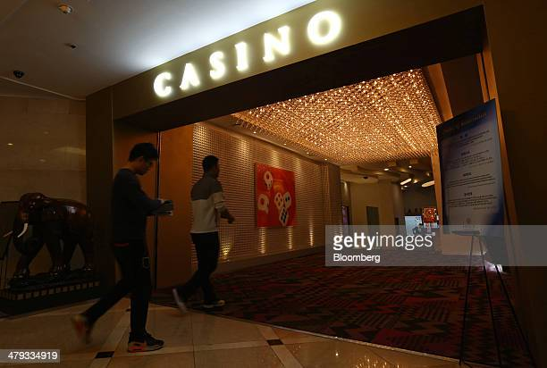 Chinese tourists enter Paradise Casino inside the Jeju Grand Hotel in Jeju South Korea on Sunday March 16 2014 South Korea plans to draw 10 million...