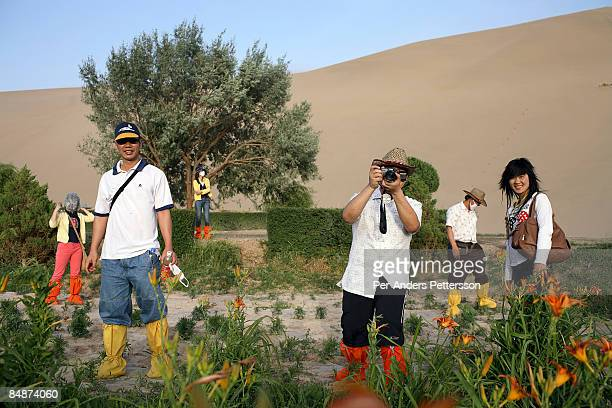 Chinese tourists in the Gobi desert.