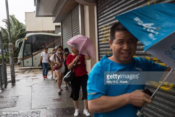 Chinese tourists shop as typhoon Hato hits Hong Kong on August 23 2017 in Hong Kong Hong Kong Hong Kong's weather authorities raised Typhoon Hato to...