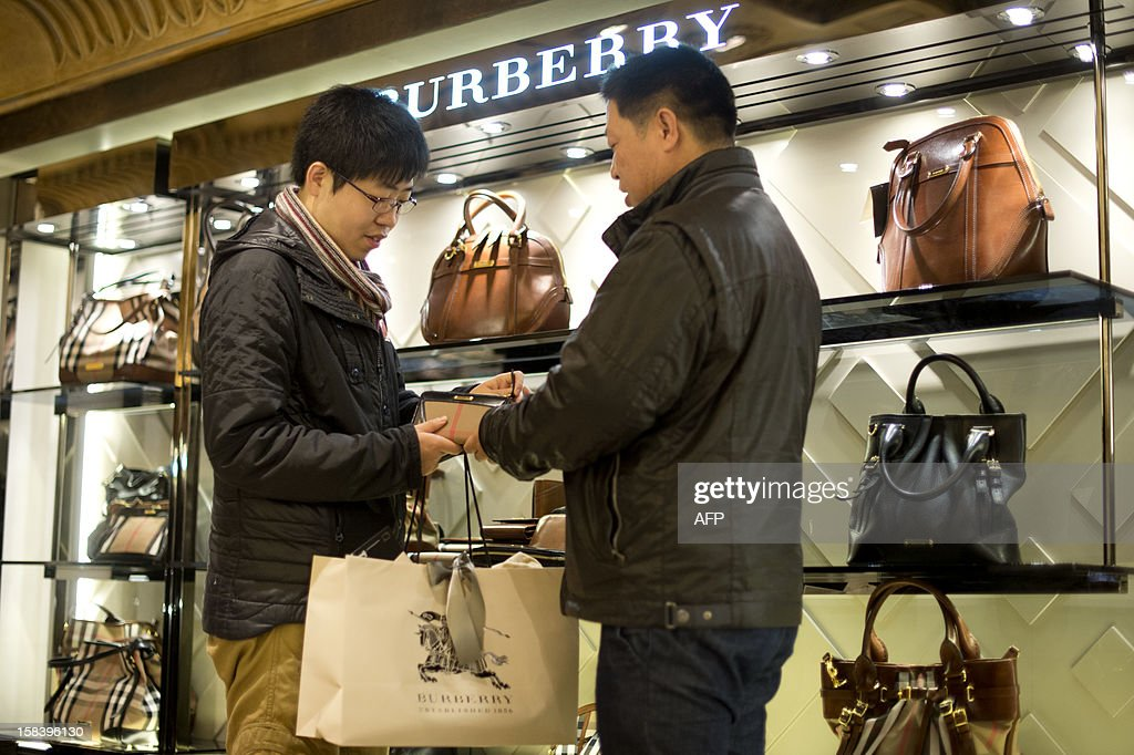 Chinese tourists shop at Harrods department store in London on December 10, 2012 two weeks ahead of Christmas. With their shelves spilling over with festive goodies, London's department stores are working hard to attract Christmas shoppers -- but Chinese visitors are the particular target of a charm offensive.