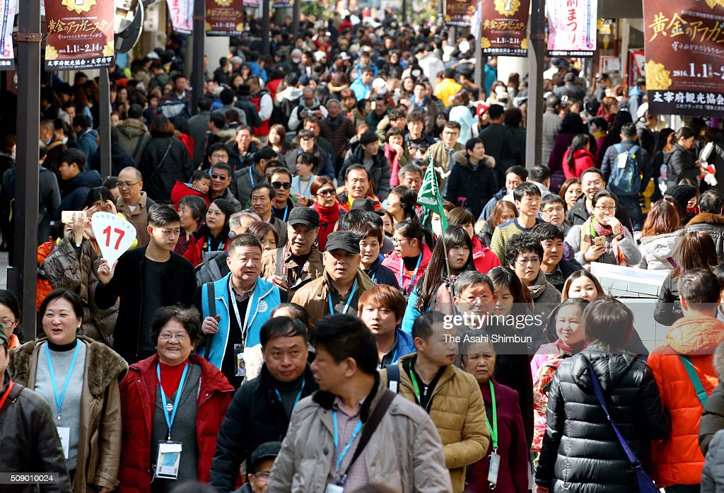 Chinese tourists spending their new year holiday in Japan walk the main approach of the Dazaifu Tenmangu Shrine on February 8, 2016 in Fukuoka, Japan. A record 19.74 million foreign tourists visited Japan in 2015, due to weaker yen