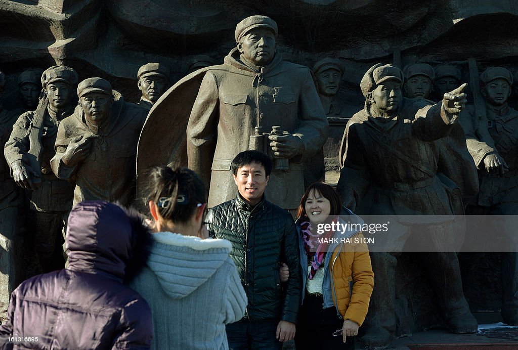 Chinese tourists take photos on the old Sino-Korean Friendship bridge which was partially destroyed by the US Air Force in 1950 and used to link North Korean with the Chinese town of Dandong on February 10, 2013. US Secretary of State John Kerry warned that North Korea's expected nuclear tests only increase the risk of conflict and would do nothing to help the country's stricken people. The country has vowed to carry out a third nuclear test soon, and concerns have been raised over the type of fissile material used in the device. AFP PHOTO/Mark RALSTON