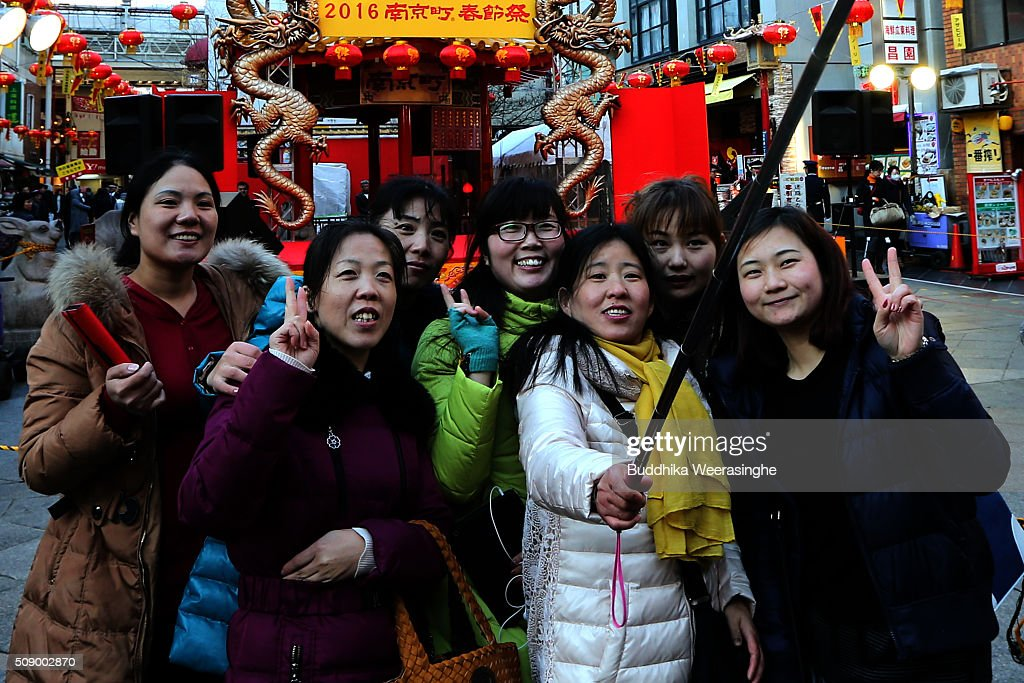 Chinese tourists take selfie at the Nankinmachi square, China Town on February 8, 2016 in Kobe, Japan. In Nankinmachi, the district known as Kobe Chinatown, tourists enjoyed Chinese food, lion dance and the parade organized to celebrate the Lunar New Year.