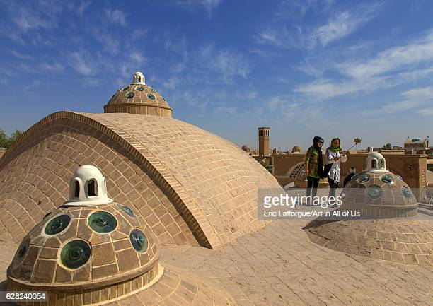 Chinese tourists taking selfie on sultan Amir ahmad bathhouse terrace Isfahan Province Kashan Iran on October 9 2016 in Kashan Iran